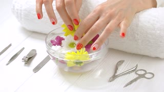 Manicured hands receiving spa procedure. Beautiful woman hands with gentle manicure receiving spa therapy in spa salon. Skin love and treatment.