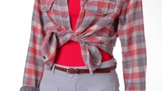 Mannequin in checkered shirt turning. Woman's bright chekered shirt. Tied shirt and thin belt. Trendy look for warm season.