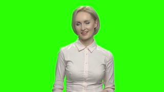Mature businesswoman dancing and snapping fingers. Green hromakey background for keying.