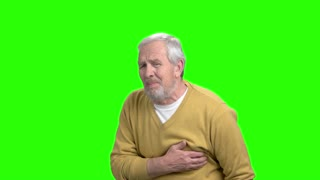 Mature man with heart attack, green screen. Unhappy man suffering from pain in chest, alpha channel background. Symptoms of infarct.