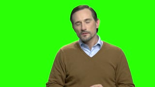 Mature man with neck pain. Green screen hromakey background for keying.