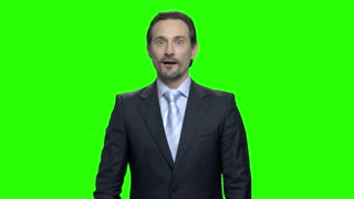 Mature shocked happy business man. Green screen hromakey background for keying.