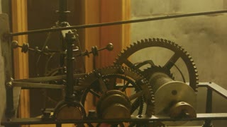 Mechanism of an old clock. Gears and pendulum, motion.