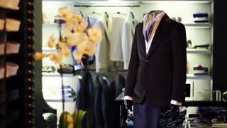 Men's jacket on a mannequin. Interior of the store. Shopping. Men's clothing store.