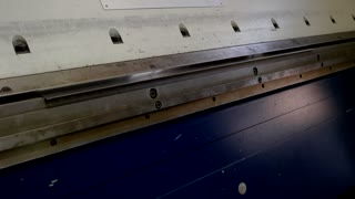 Metal bending machine. Steel sheet and hydraulic press. Fabrication of airplane parts.