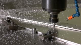 Metal milling machine in action. Steel and drill. Inch by inch.
