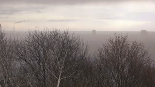 Mist above industrial city. Cloudy and depressive landscape.