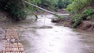 Mountain river in the jungle. Bamboo rafts. Tropical river.
