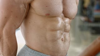 Muscular torso. Bodybuilder with huge muscles. Strong man's torso. Picture of muscular torso, arms and abs.