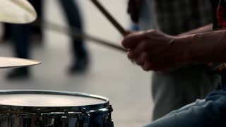 Musical concept with the working drum. Slow motion. Close up.