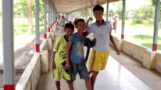 Myanmar, Yangon. 19/11/2013. Asian boy fool around in front of the camera. Funny boys. Children play with each other.