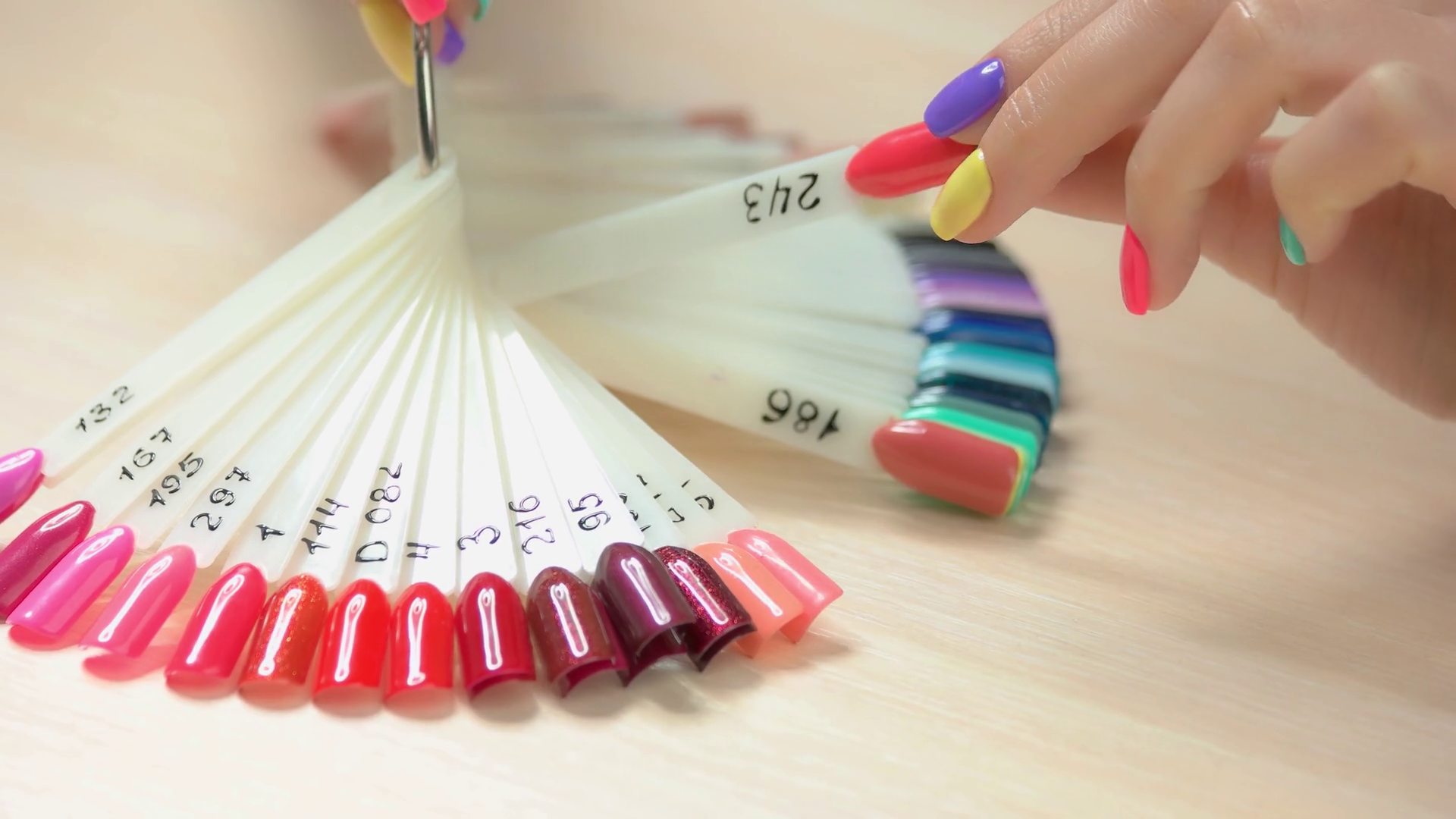 Nail Art Fashion Design Samples Young Woman Hand With Perfect Summer Manicure Choosing Nail Polish Color In Nail Salon Artificial Nails On Transparent Basis Varnish Color Palette For Nails Stock Video Footage