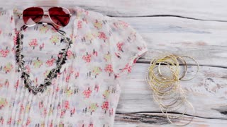 Necklace and summer blouse. Lime purse, blouse and bracelets. Lady's trendy clothing and accessories. Best prices in fashion store.