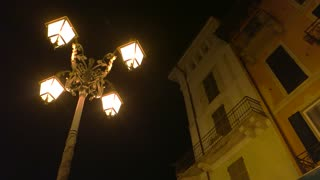 Night in Stresa. Street light and classic building.