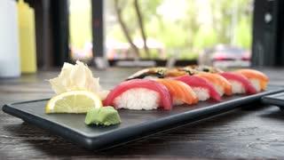 Nigiri and sashimi close up. Rice and raw fish.