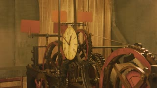 Old clock mechanism. Clockface and cogwheels. The power of time.