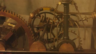 Old clock mechanism close up. Pendulum and cogs. How timepieces work.