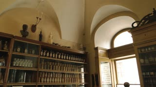 Old drugstore interior. Medicaments and scales. History of medicine.