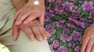Old hands. Hand of the old woman's stroking grandfather hand .