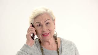 Old lady talking on phone. Elderly woman isolated. Best prices for international calls.