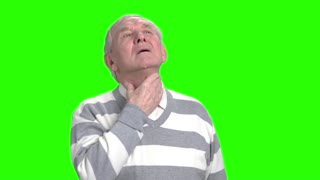 Old man has thore throat and coughing. Grandpa got a flu, green hroma background.