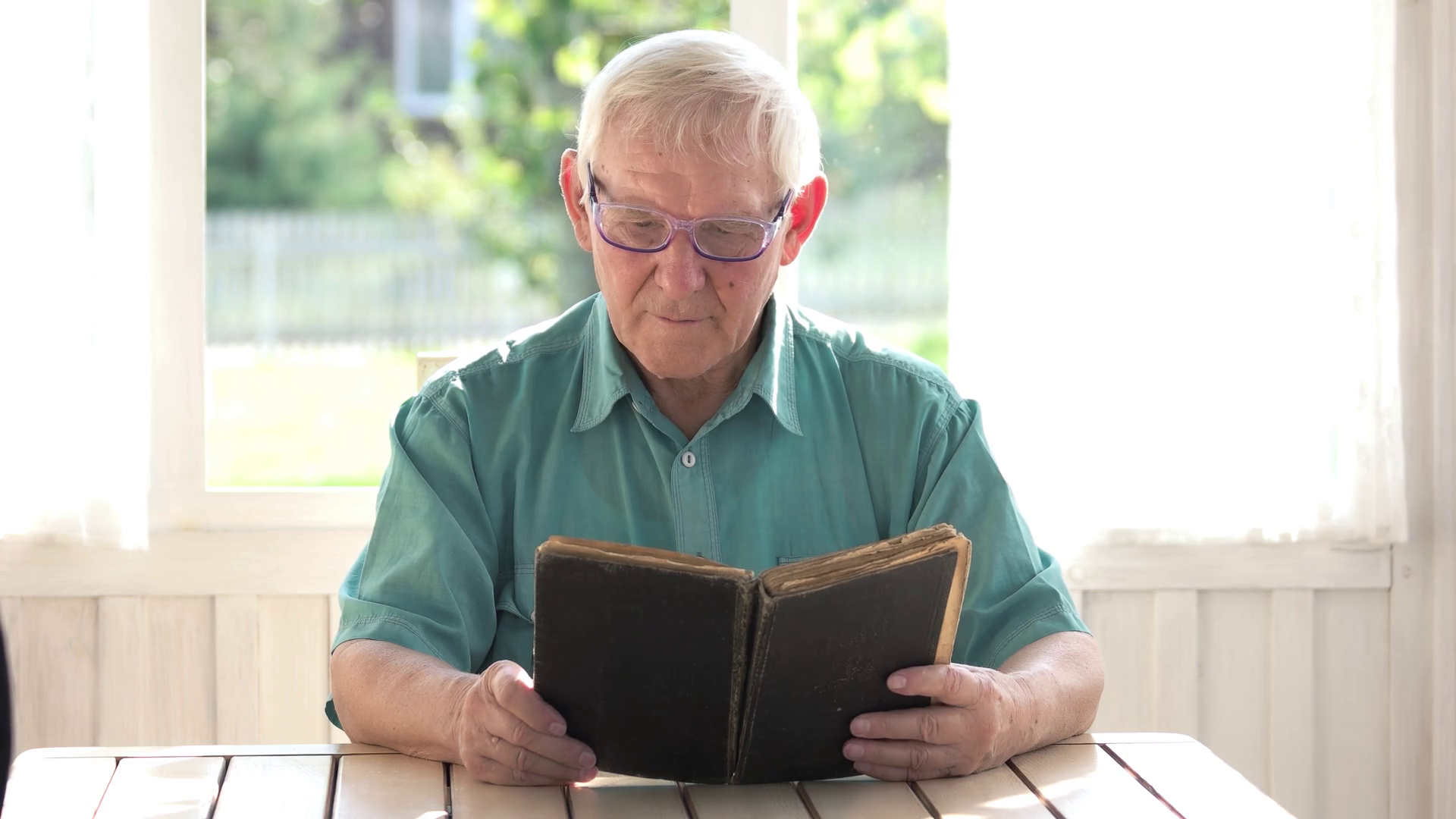 Old man reading a book. Elderly male in glasses. Most interesting novel.  Stock Video Footage - Storyblocks