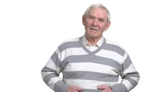 Old man with stomach problems. Mature man holding stomach with painful discomfort, white background. Abdominal pain in elderly persons.