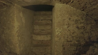 Old stone cellar. Stairs and damaged wall. Creepiest places on Earth.