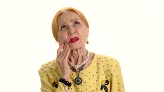 Old woman having toothache. Lady on white background. Dental pain relief.