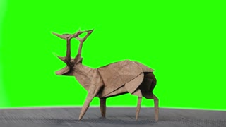 Origami deer on green screen. Animal made from paper on chroma key background. Beauty of origami design.