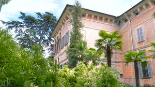 Palazzo Borromeo, Isola Madre. Palm trees and classic building.