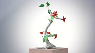 Paper origami plant. Origami exposition in white background.