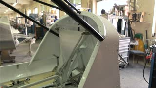 Part of airplane in workshop. Aircraft cockpit during construction. Modern aviation industry.
