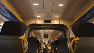 Passenger train seats. Inside modern train wagon, people. Train travel classes.