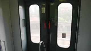 Passenger train wagon doors. Train in motion, day.
