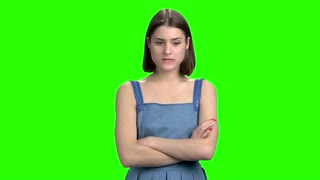 Pensive thoughtful young woman. Green screen hromakey background for keying.