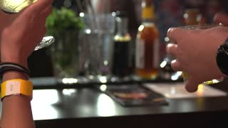 People holding glasses of alcohol drinks. Close up hands with glasses of cocktails.