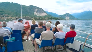 People on a boat Italy. Tourists, lake Maggiore scenery.