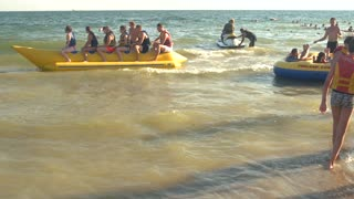 People on banana boat. Water, sun and fun.
