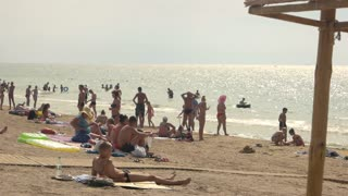 People on the sea beach. Hot july day.