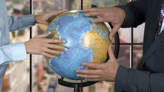 People touching globe. Young lady and businessman. In search for solution. Think out the best strategy.