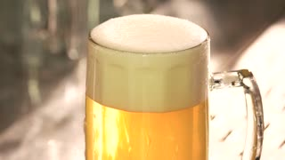 Perfect beer froth. Head of beer with perfect foam. Beer foam reducing.