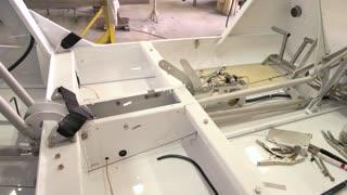 Plane cockpit in workshop. Tools on metal background.