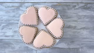 Plate with heart shaped cookies. Biscuits in a shape of heart, top view. Try taste of love.