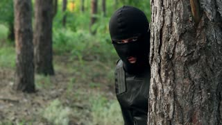 Police are preparing to arrest the perpetrator. Bandits are preparing an attempt. Ambush of criminals in the forest. Terrorists preparing a terrorist attack.