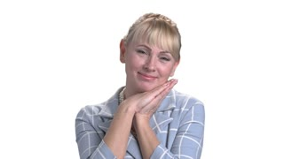 Portrait of adorable mature woman. Adult woman clasped her hands under chin isolated on white background.