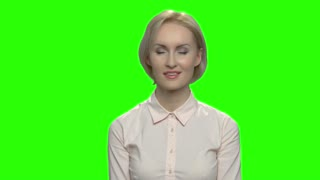 Portrait of amazed businesswoman. Green hromakey background for keying.