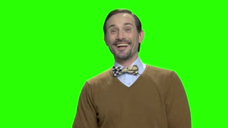Portrait of handsome middle aged man laughing hard. Excited cheerful man. Green screen hromakey background for keying.