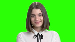 Portrait of sexy girl flirting with her object of love. Smiling cute brunette girl face, positive facial expresions. Green screen hromakey background for keying.