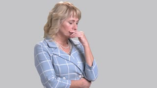 Portrait of worried woman on grey background. Frustrated business woman, side view. Problem and stress expression.